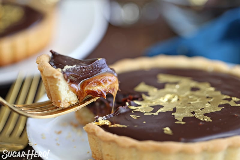 Close-up of fork taking a bite out of a Baileys Chocolate Caramel Tart