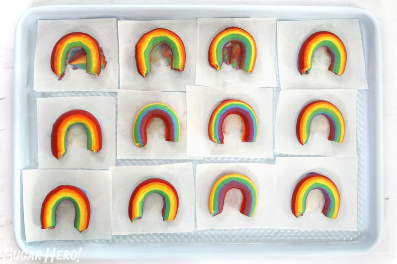 Baking sheet with rows of Buttercream Rainbows on parchment squares