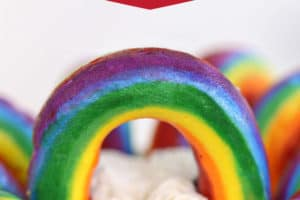Close-up of Buttercream Rainbows with text overlay for Pinterest
