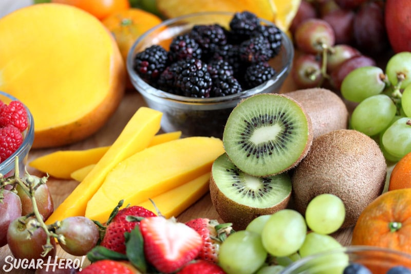 Close-up of various fresh fruits on a wooden platter