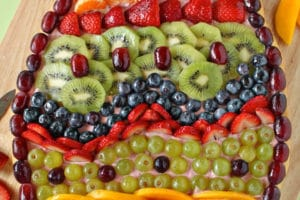 Easter Egg Fruit Pizza photo with text overlay for Pinterest