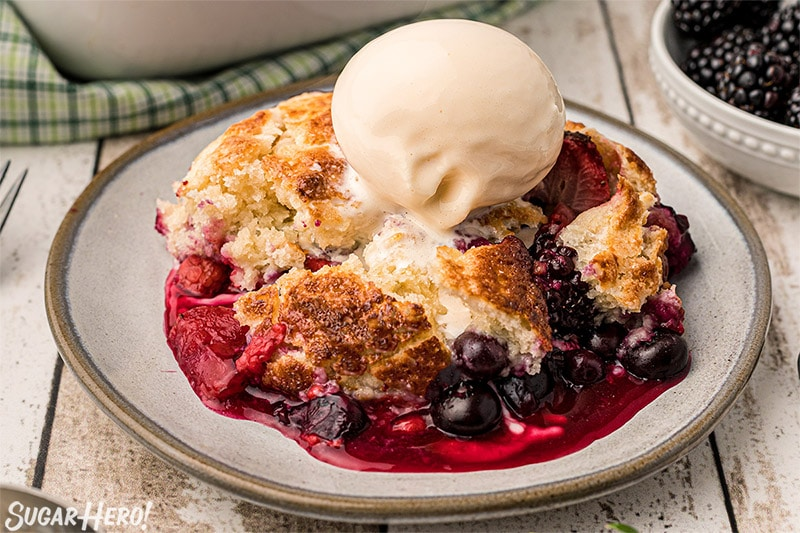 Close-up of Mixed Berry Cobbler with a scoop of vanilla ice cream