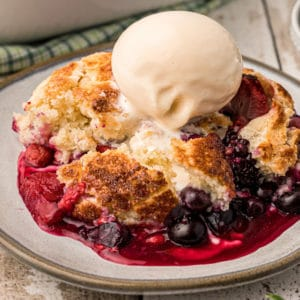 Close-up of berry cobbler with vanilla ice cream on top