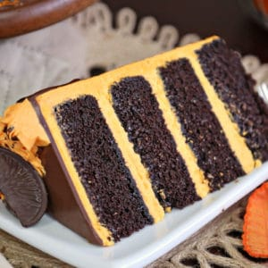 Slice of chocolate cake with orange buttercream between the layers