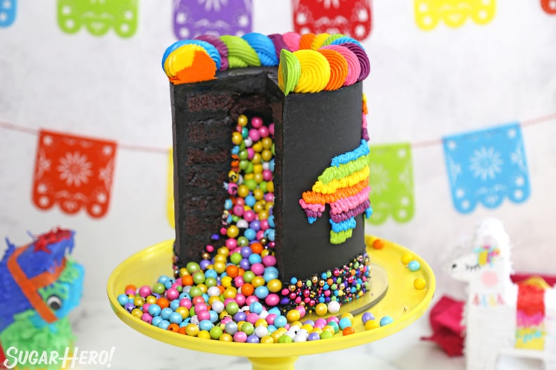 Chocolate pinata cake cut open, with colorful candy spilling out