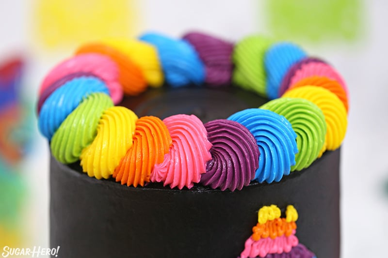 Close-up of a colorful neon buttercream border