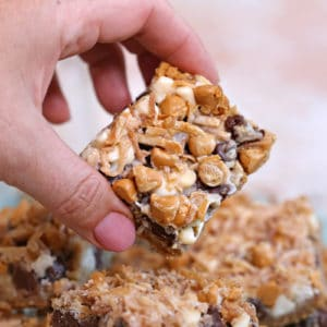 Hand holding up a Seven Layer Bar