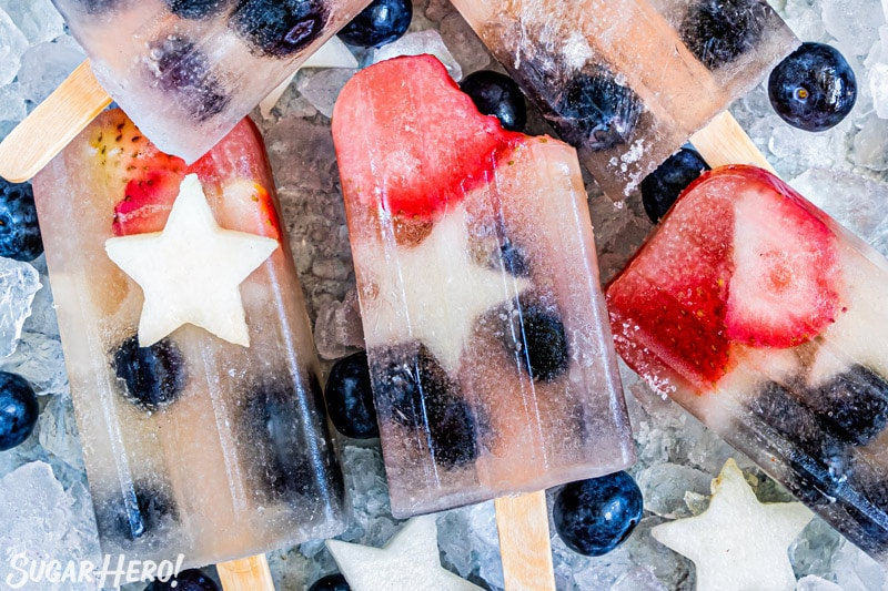 Close-up of Homemade Fruit Popsicles with a bite taken out of one of them