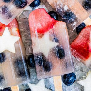 Close-up of Homemade Fruit Popsicles with a bite taken out of the corner