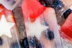 Photo of Red White & Blue Popsicles with text overlay for Pinterest