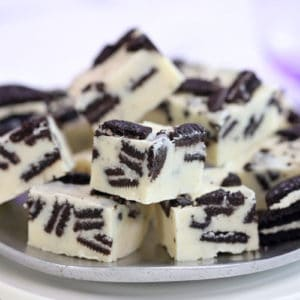 Oreo Fudge on a silver plate with a purple background.