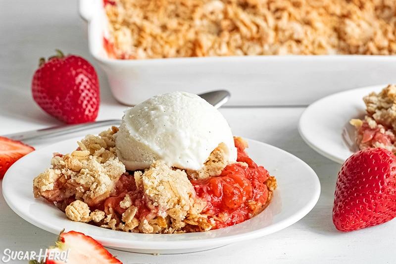 Scoop of Strawberry Crisp with vanilla ice cream on top.