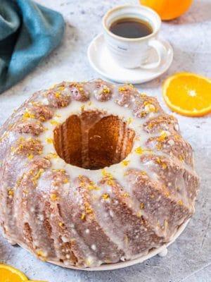 Orange Bundt Cake with an orange glaze and orange zest on top.