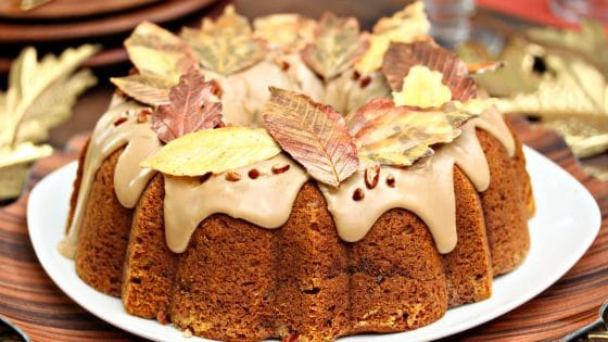 Pumpkin Pound Cake with brown sugar glaze and chocolate leaves on top.