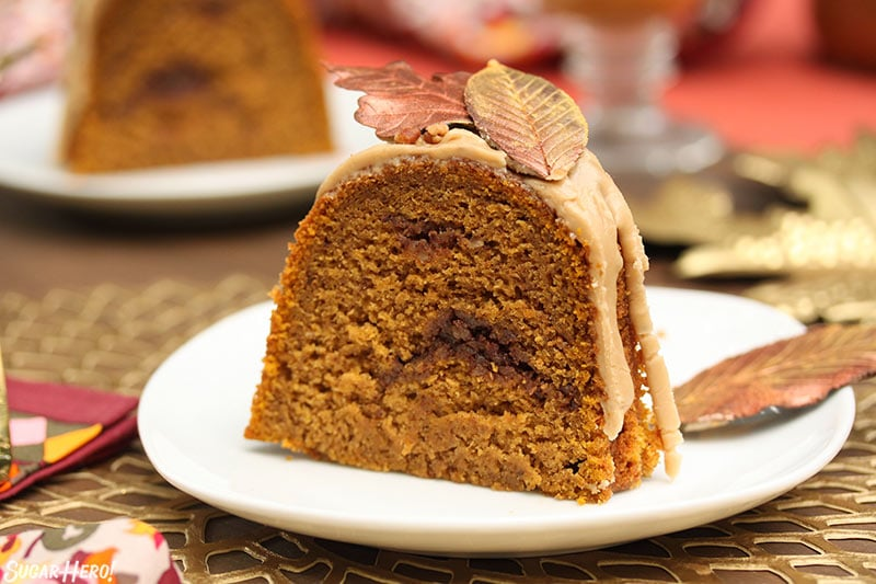 Slice of pumpkin cake with a cinnamon swirl in the middle.